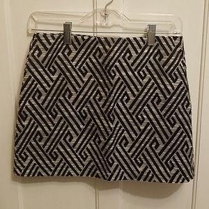 Black and white geometric mini skirt